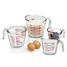 MEASURING CUP, CLEAR WITH RED DECORATION, GLASS